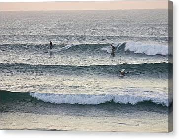 Surfers Crowd The Lineup As Waves Peel Canvas Print by Jason Edwards