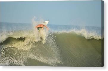 Surfing Rocks Canvas Print by Lynda Dawson-Youngclaus