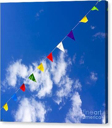 Suspended Festive Flags. Canvas Print by Bernard Jaubert