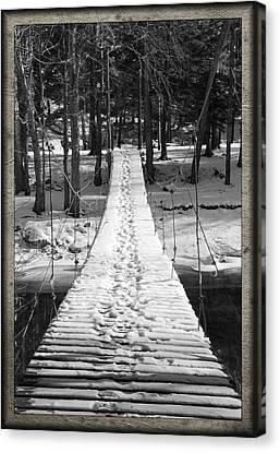 Swinging Cable Foot Bridge Canvas Print by John Stephens
