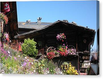 Swiss Chalet Interlaken Canvas Print by Marilyn Dunlap