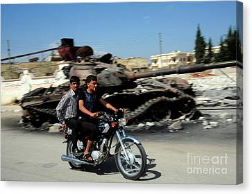 Syrian Men Drive A Motorbike Canvas Print by Andrew Chittock