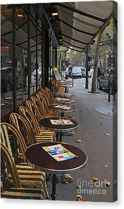 Tables Outside A Paris Bistro On An Autumn Day Canvas Print by Louise Heusinkveld