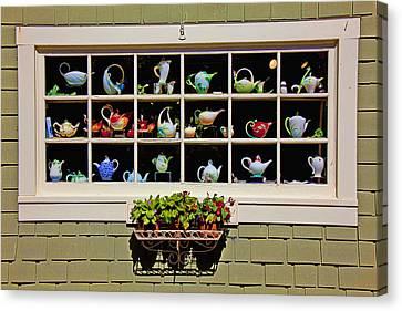 Tea Pots In Window Canvas Print by Garry Gay