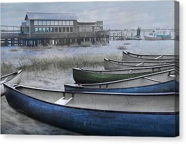 The Green Canoe Canvas Print by Debra and Dave Vanderlaan