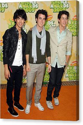 The Jonas Brothers At Arrivals Canvas Print by Everett