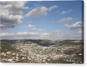 The Jordanian Countryside And The Town Canvas Print by Taylor S. Kennedy