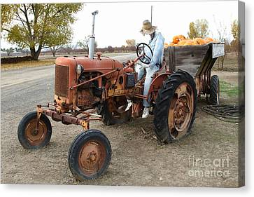 The Scarecrow Riding On The Old Farm Tractor . 7d10299 Canvas Print by Wingsdomain Art and Photography