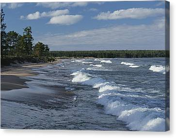 The Surf Breaks On A Beach Canvas Print by Raymond Gehman