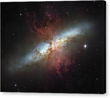 This Galaxy Is Called The Cigar Galaxy Canvas Print by ESA and nASA