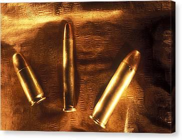 Three Golden 38 Calibre Bullets Canvas Print by Lyle Leduc