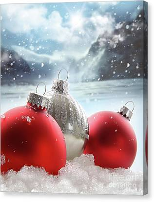 Three Red Christmas Balls In The Snow Canvas Print by Sandra Cunningham