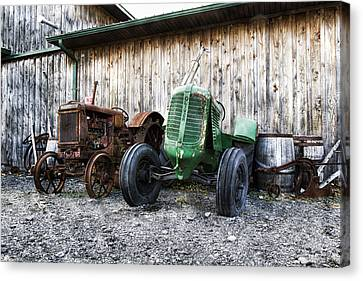 Tired Tractors Canvas Print by Peter Chilelli