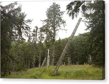 Totem Poles Stand In A Deserted Village Canvas Print by Taylor S. Kennedy