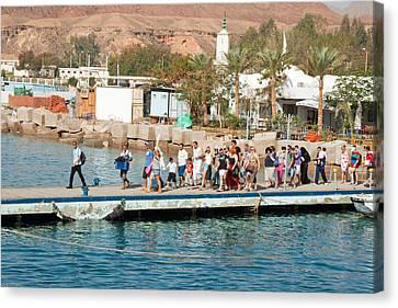 Tourists Waiting To Climb Onto Dive And Snorkeling Boats At Sharm El Sheikh Canvas Print by Ashish Agarwal