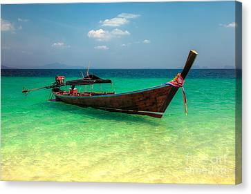 Tropical Boat Canvas Print by Adrian Evans