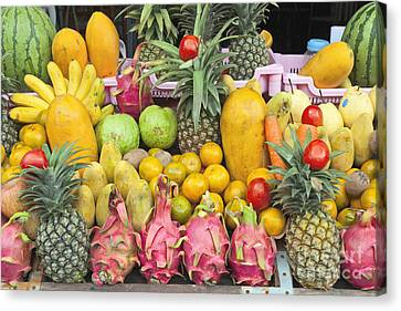 Tropical Fruit Display  Canvas Print by Roberto Morgenthaler