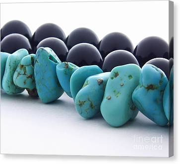 Turquoise Stones And Black Pearls Canvas Print by Blink Images
