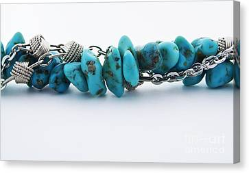 Turquoise Stones And Silver Chain Canvas Print by Blink Images