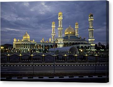 Twilight View Of An Illuminated Mosque Canvas Print by Paul Chesley