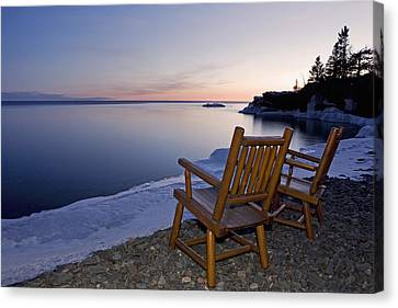 Two Chairs At Waters Edge Looking Out Canvas Print by Susan Dykstra