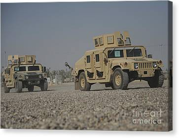 Two M1114 Humvee Vehicles At Camp Taji Canvas Print by Stocktrek Images