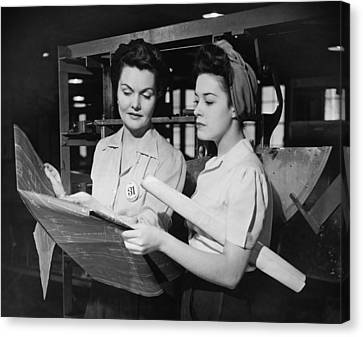 Two Women In Workshop Looking At Blueprints, (b&w) Canvas Print by George Marks
