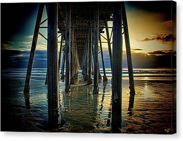 Under The Boardwalk Canvas Print by Chris Lord