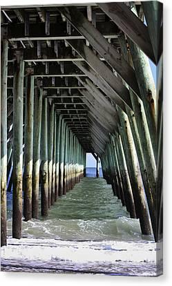 Under The Pier Canvas Print by Teresa Mucha