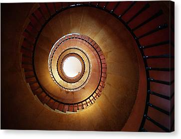 Underneath A Stone Spiral Staircase Looking Up Canvas Print by Tracy Packer Photography