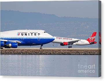 United Airlines And Virgin America Airlines Jet Airplanes At San Francisco International Airport Sfo Canvas Print by Wingsdomain Art and Photography