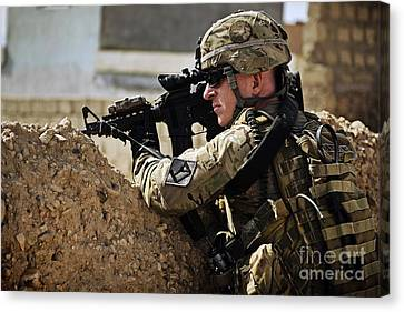 U.s. Army Sergeant Pulls Security While Canvas Print by Stocktrek Images