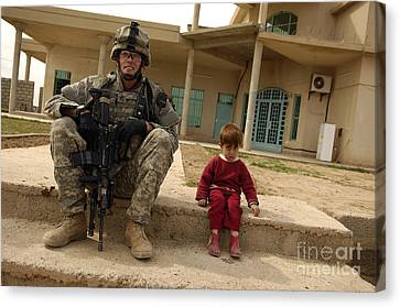 U.s. Army Sergeant Sits Next To An Canvas Print by Stocktrek Images