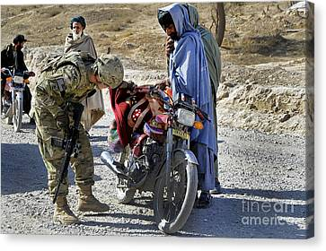 U.s. Army Soldier Conducts Vehicle Canvas Print by Stocktrek Images