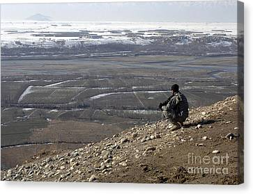 U.s. Army Soldier Looks Canvas Print by Stocktrek Images