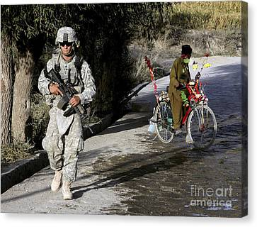 U.s. Army Soldier Patrols Canvas Print by Stocktrek Images