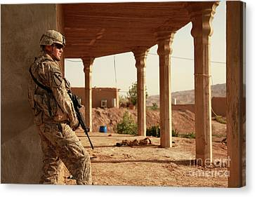 U.s. Army Soldier Pulls Security Canvas Print by Stocktrek Images