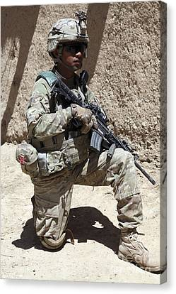 U.s. Army Soldier Takes A Knee While Canvas Print by Stocktrek Images