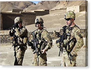 U.s. Army Soldiers Coordinate Security Canvas Print by Stocktrek Images