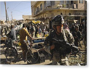 U.s. Army Specialist Moves Through An Canvas Print by Stocktrek Images