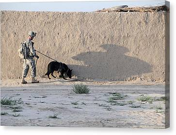 Us Army Working Dog Team Conducts Canvas Print by Everett