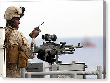 U.s. Marine Talks On A Radio While Canvas Print by Stocktrek Images