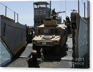 U.s. Marines Load An M1114 Humvee Onto Canvas Print by Stocktrek Images