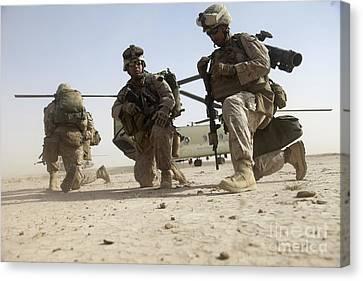 U.s. Marines Unloading Canvas Print by Stocktrek Images