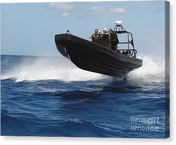 U.s. Navy Sailors Operate A Nine-meter Canvas Print by Stocktrek Images