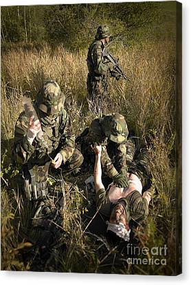 U.s. Navy Seals Give First Aid Canvas Print by Tom Weber