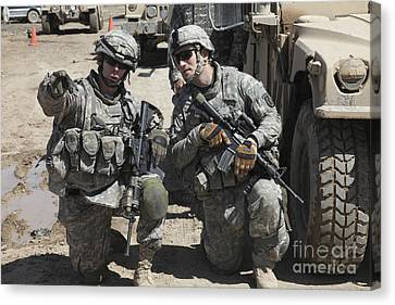 U.s. Soldiers Coordinate Security Canvas Print by Stocktrek Images