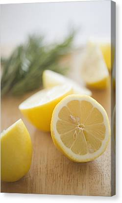 Usa, New Jersey, Jersey City, Lemon On Chopping Board Canvas Print by Jamie Grill