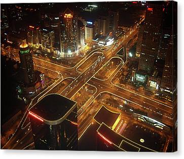 View Of Cityscape At Night Canvas Print by Philip M Walker