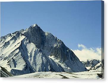 View Of Snow-covered Mountain Ridges Canvas Print by Gordon Wiltsie
